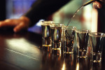The average drinker downs 374 shots of pure alcohol a year.